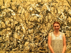 Greta by a Pollock painting.